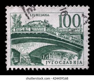 ZAGREB, CROATIA - SEPTEMBER 11: Postage stamp printed in Yugoslavia shows Triple bridge, Ljubljana, circa 1958, on September 11, 2014, Zagreb, Croatia