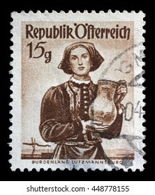 ZAGREB, CROATIA - SEPTEMBER 13: A stamp printed in Austria shows image woman in national Austrian costumes, Burgenland, Lutzmannsburg, series, circa 1948, on September 13, 2014, Zagreb, Croatia