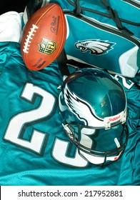ZAGREB , CROATIA - SEPTEMBER 17 , 2014 :  NFL Philadelphia Eagles club equipment , ball, helmet, jersey and bag, product shot