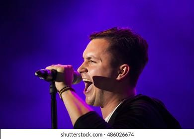 ZAGREB, CROATIA - SEPTEMBER 17, 2016: Domagoj Pisuljak frontman of OSDS band during opening act of Opca opasnost rock band concert on Salata stadium in Zagreb
