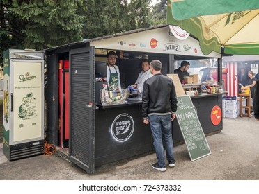 Zagreb, Croatia - September 24, 2017: People visit Zagreb Burger street food festival near the Academia building.