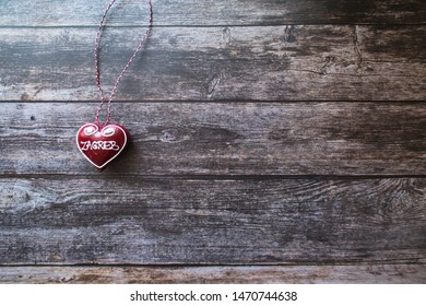 Zagreb heart souvenir in the wooden background