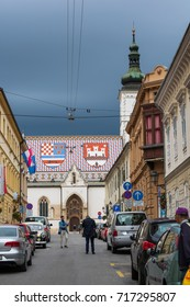 ZAGREB, SEPTEMBER 15, 2017: Old town street leading to St. Mark's square in Zagreb, stormy clouds above St.Mark's church, Croatia