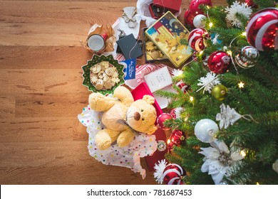 ZAGREB,CROATIA- DECEMBER 26,2017: Top view of unwrapped Christmas gifts under a decorated Christmas tree, vintage tone, after Christmas or holidays concept. Illustrative editorial.