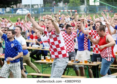 ZAGREB,CROATIA - JUNE 17,2016 : Croatian football fans on the playground at Jarun, watching EURO 2016 match Czech Republic vs Croatia in Zagreb,Croatia.Fans celebrate a goal that is scored by Croatia.