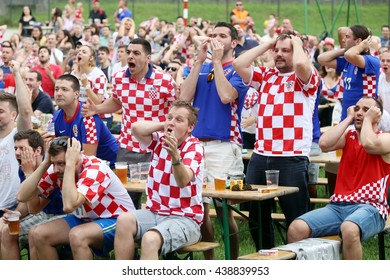 ZAGREB,CROATIA - JUNE 17,2016 : Croatian football fans on the playground at Jarun,watching EURO 2016 match Czech Republic vs Croatia in Zagreb,Croatia.Fans disappointed by missed shot of Croatia team.