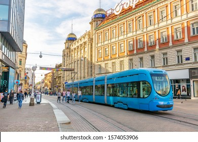 Zagreb,Croatia- October 21st 2019: Tram in the center of zagreb with people and tourists walking on the street.