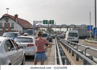 ZAHONY, HUNGARY - AUGUST 5: Traffic jam on the Ukrainian-Hungarian border (between Chop, Ukraine and Zahony, Hungary) customs checkpoint on bridge over Tisa river on August 5, 2012 in Zahony, Hungary.