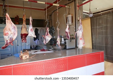ZAIDA, MOROCCO - FEB 14, 2019 - Sides of beef and lamb hanging in a BBQ restaurant in Zaida, Morocco, Africa