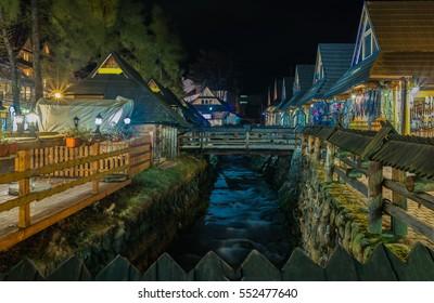 ZAKOPANE, POLAND - 2016: Krupowki street in Zakopane creek at night