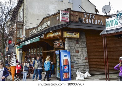 ZAKOPANE, POLAND - APRIL 20, 2014: The entrance to the Stek Chalupa restaurant at the central part of Krupowki street, restaurant offers typical of traditional Polish cuisine and regional specialties