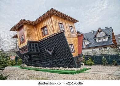 ZAKOPANE, POLAND - APRIL 21, 2017 ; Attraction Upside Down House in Zakopane.