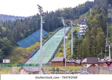 ZAKOPANE, POLAND - AUG 3, 2015: Wielka Krokiew (The Great Krokiew), ski jumping venue on the slope of Krokiew mountain (1378 m) in Zakopane. It is a regular venue in the FIS Ski jumping World Cup