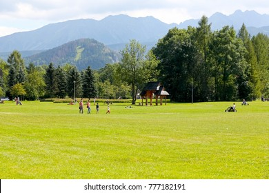 Zakopane, Poland - August 15, 2017: Extensive areas with trees almost in the city center that is park area it is called The Rowien Krupowa after the surname of the former owners of this land