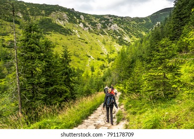 ZAKOPANE, POLAND - AUGUST 16, 2016: Mountain hikers or group of people on hiking trail in mountains, green landscape