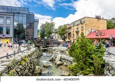 ZAKOPANE, POLAND - AUGUST 17, 2016: Touristic season in Zakopane, city center, promenade with people, tourist mountain resort