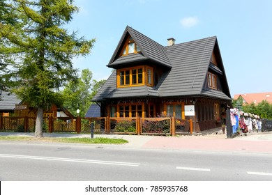Zakopane, Poland - August 17, 2017: The building with the new roofing with a structure that meets most architectural features of the region is fenced and visible near the street and is named Willa Art