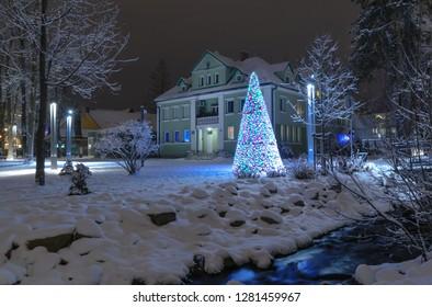 ZAKOPANE, POLAND - DECEMBER 24, 2018: The Christmas tree near river in winter Park in Zakopane. Poland.