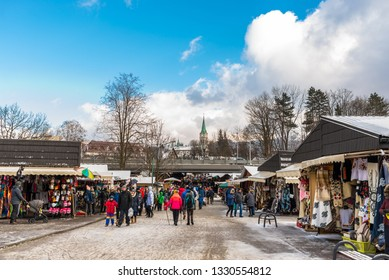 Zakopane, Poland - February 22, 2019. A crowd of people is walking along Krupowki street on an winter day. Krupowki street is the main city promenade in Zakopane.The street is filled with souvenir.