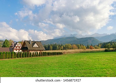 ZAKOPANE, POLAND - JULY 27, 2018: Highlanders houses and panorama of the Tarta mountains in Zakopane, Poland.