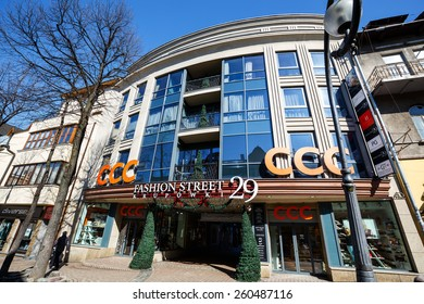 ZAKOPANE, POLAND - MARCH 09, 2015: Gateway to Fashion Street Krupowki 29, shopping avenue length of over 120 meters brings together 43 luxury boutiques of the world's top brands