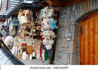 Zakopane, Poland - March 17, 2018: Various traditional stuff is exposed for sell at the marketplace in the city. Stylized traditional products and toys are available there.