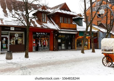 Zakopane, Poland - March 19, 2018: The wooden residential building dates back to around 1900 and is located at Krupowki Street. There are shops and restaurants on the ground floor.