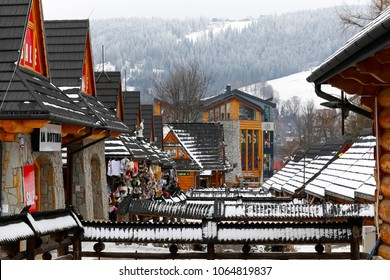 Zakopane, Poland - March 19, 2018: Handrails and bridges connecting two rows of commercial pavilions located on both sides of the brook. Locally, this place of trade is called Goralskie Sukiennice