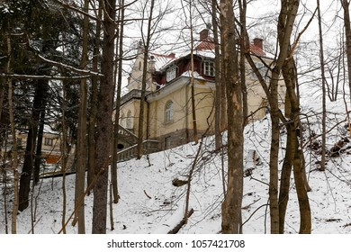 Zakopane, Poland - March 20, 2018: There is a house hidden on a hill, between trees. It is a manor house style villa dating back around 1924 and nowadays there is an art gallery in the interiors.