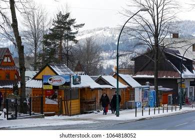 Zakopane, Poland - March 21, 2018: Small shopping pavilions are located along the pavement on one of the streets in the city. Due to the low season all of them are closed
