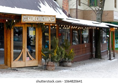 Zakopane, Poland - March 21, 2018: Entrance door and front window of the regional restaurant that is locally named as Kolorowa . This place is on the main shopping street called Krupowki