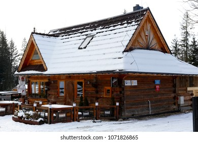 Zakopane, Poland - March 21, 2018: The wooden building, which was built in the style of a mountain cottage, houses a restaurant and a cafe. This is shown here during winter.