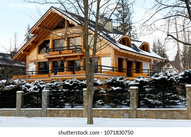 Zakopane, Poland - March 21, 2018: Modern design based on elements of the region's traditional design is a showpiece of the architecture of this large, beautiful villa.