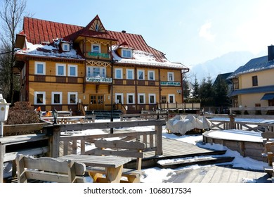 Zakopane, Poland - March 22, 2018: The wooden building where the hotel is located is locally called Kasprowy Wierch. This historic building dates back to 1892.