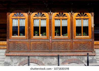 Zakopane, Poland - March 22, 2018: The ornamental outer part of the veranda is part of a historic house, which is locally known as Villa Slimak