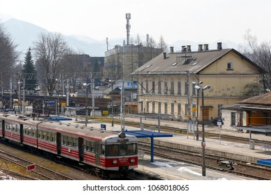 Zakopane, Poland - March 23, 2018: The train has stopped at the railway station and is waiting for its next trip. In the area you can see various buildings and in the distance there are hills.