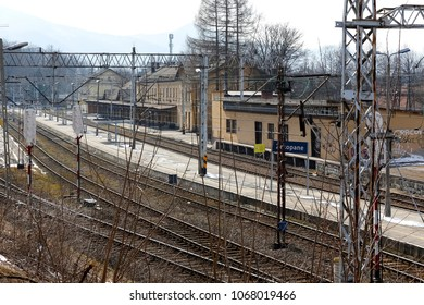 Zakopane, Poland - March 23, 2018: Railway tracks, buildings, overhead contact line and infrastructure. It is a view of the railway station which ends the railway line in this city.