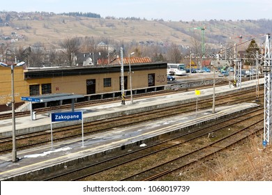 Zakopane, Poland - March 23, 2018: Platforms, railway tracks and a small building among the surrounding hills is a railway station where there are no trains here.