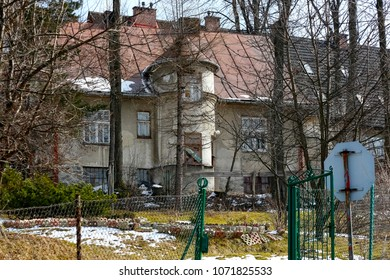 Zakopane, Poland - March 23, 2018: The brick residential building, which appears to be abandoned, dates back to around 1930 and most probably used to be called Iwonka locally in the past.