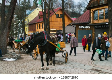 ZAKOPANE, POLAND - MARCH 8, 2019: Shopping in the historic street of Zakopane mountain village, Poland