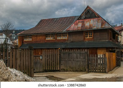 ZAKOPANE, POLAND - MARCH 9, 2019: Traditional wooden house in the mountain village of Zakopane, Poland