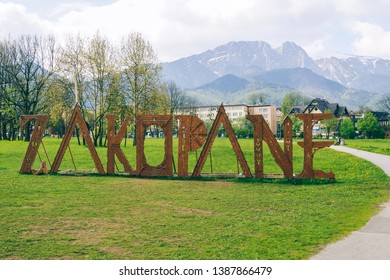 Zakopane, Poland - May 21, 2016: Huge lettering creates name of the city. Wooden letters are made using elements ornamentation of the architectural style of Zakopane.
