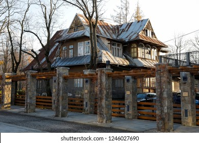 Zakopane, Poland - November 10, 2018: The house made of wood in the Zakopane style dates back to around 1896. The house, which was later plastered, is the former seat of a music school.