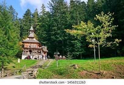 ZAKOPANE, POLAND - OCTOBER 02, 2016: Jaszczurowka, famous wooden chapel in Zakopane, Poland.