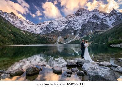 Zakopane, Poland, October 23, 2016. Newlyweds on Morskie Oko Lake in High Tatras.