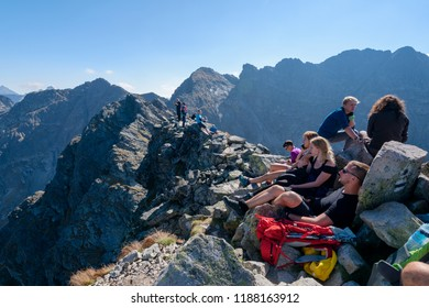 Zakopane, Poland - Sept 19, 2018: Hikers resting on the Koscielec peak in the High Tatras, Poland