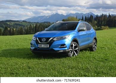 Zakopane, Poland - September, 07, 2017: Nissan Qashqai car parked on the grass with mountains view.