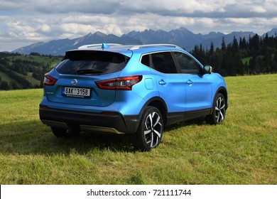 Zakopane, Poland - September, 07, 2017: Nissan Qashqai car parked on the grass with mountains view.