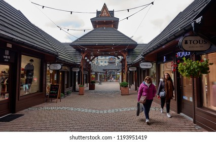 ZAKOPANE, POLAND - SEPTEMBER 29, 2018: Shopping arcade at Krupowki street on 29 September 2018 in Zakopane, Poland. Krupowki is the main street of the city with many shops and restaurants.