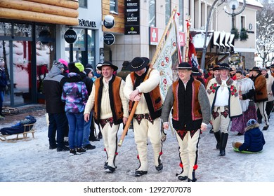 Zakopane/Poland - 13 January 2019: Polish people in national clothes, in Zakopane. Krupowki street, the main city promenade in Zakopane, Poland. The Tatra Mountains.